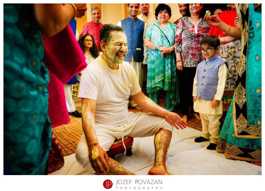 kelowna wedding photographer Delta hotel ceremony groom pithi